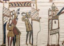 pessoas apontando cometa em tecido bordado