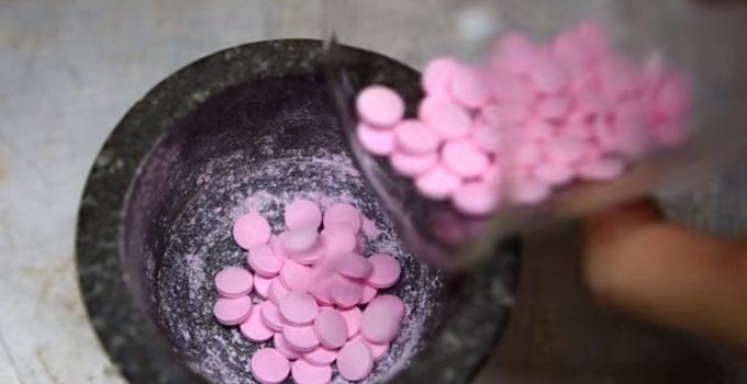 medicamento de cor rosa